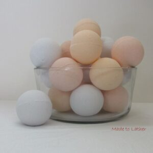 bowl of made to lather bath bombs