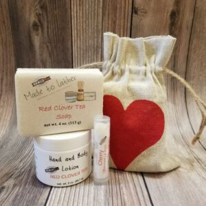 gift bag with a bar of soap, jar of lotion and lip balm tube by Made to Lather