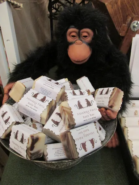 bowl of monkey fart's soap by Made to Lther in front of a stuffed monkey