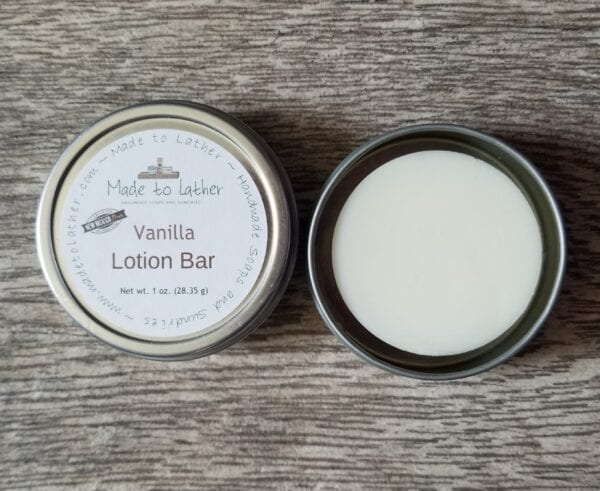 made to lather vanilla lotion bar in a tin