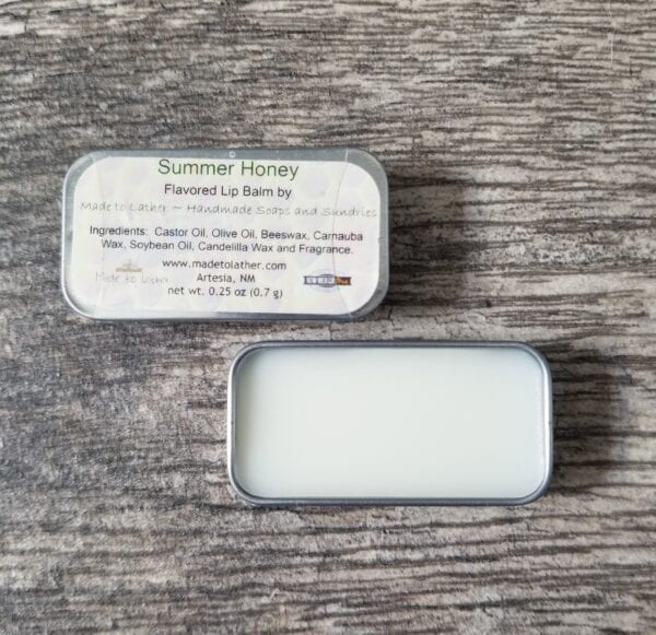 two tins of Made to Lather's Summer Honey lip balm