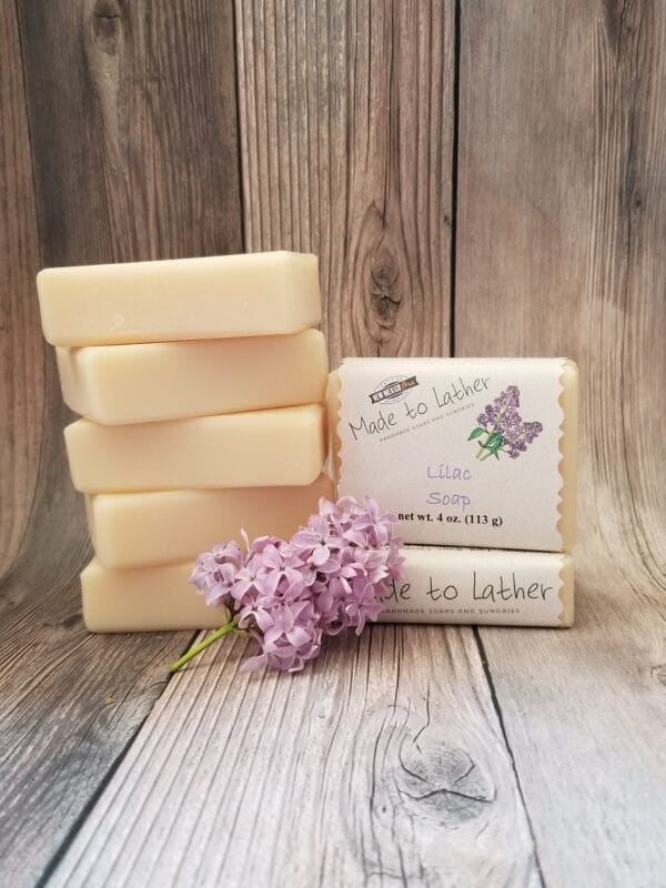 stack of bar bars soaps with a sprig of lilac flowers by Made to Lather