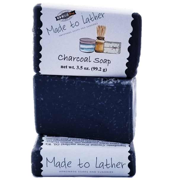 three bars stacked of made to lather's charcoal soap