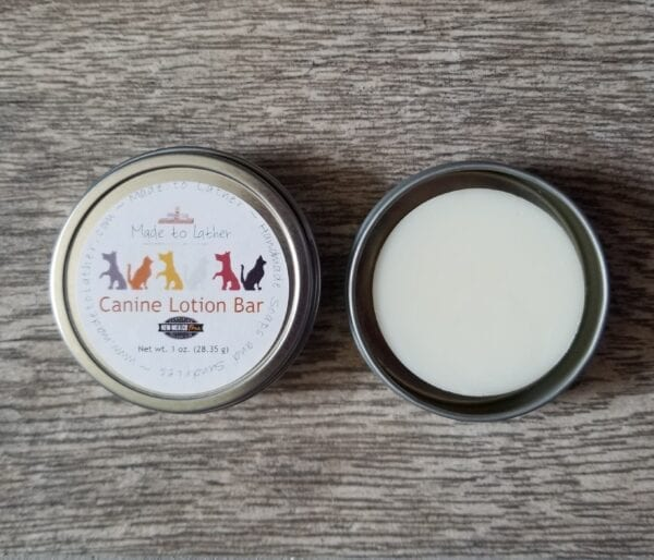 a canine lotion bar packaged in a round tin