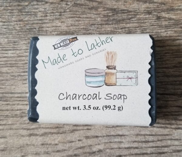 a bar of made to lather's charcoal soap